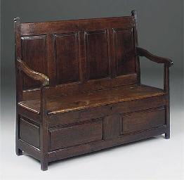 AN OAK BOX SEAT SETTLE