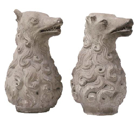 A PAIR OF SCULPTED STONE ARMOR