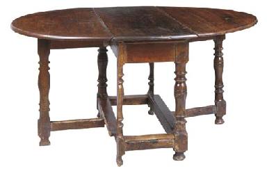 AN OAK OVAL GATELEG TABLE