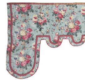 A GLAZED CHINTZ SHAPED PELMET