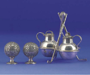 A WHITE-METAL CRUET SET