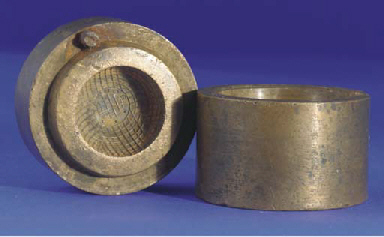 A BRASS GUTTY GOLF BALL MOULD