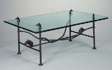 A PATINATED BRONZE AND GLASS T