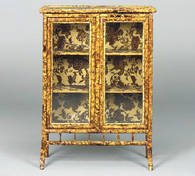 A BAMBOO LACQUERED AND EMBOSSE