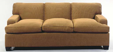A BROWN UPHOLSTERED SOFA,