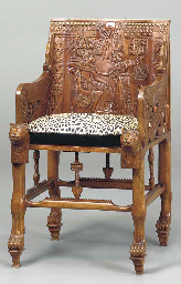 AN EGYPTIAN REVIVAL CARVED AND
