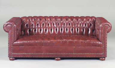 A RED LEATHER UPHOLSTERED CHES