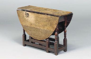 AN ENGLISH OAK DROP-LEAF TABLE