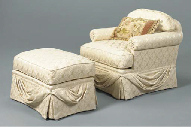 A CREME UPHOLSTERED ARMCHAIR A