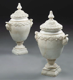 A PAIR OF WHITE MARBLE URNS AN
