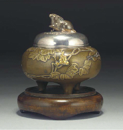 A Japanese bronze and inlaid t