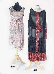 An evening dress of black wool