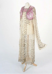 An evening dress of embroidere