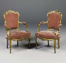 A PAIR OF CARVED GILTWOOD FAUT