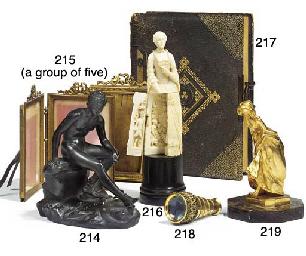 A group of five gilt brass pho