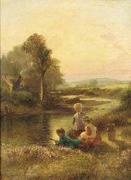 Children fishing by a stream