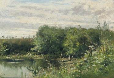 A fisherman by a lake