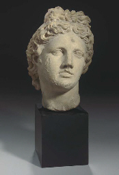 AN ITALIAN MARBLE HEAD OF APOL