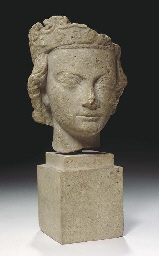 A FRENCH LIMESTONE HEAD OF A K