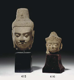 A KHMER RED SANDSTONE HEAD OF