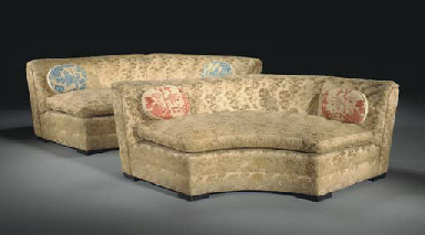 A PAIR OF UPHOLSTERED CURVED S