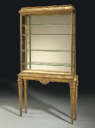 A GILTWOOD AND BRASS VITRINE C