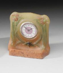 A PATE-DE-VERRE CLOCK WITH BEE