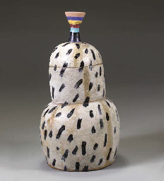 A LARGE STONEWARE VESSEL WITH