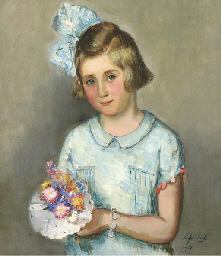 Girl in a blue dress with a bo