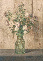 A still life with flowers in a