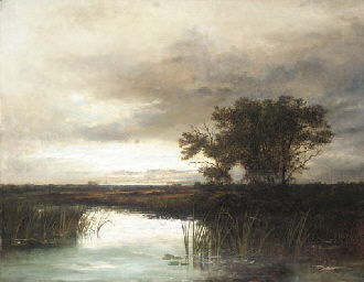 View of a lake with fields bey