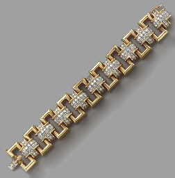 AN 18K GOLD AND DIAMOND BRACEL