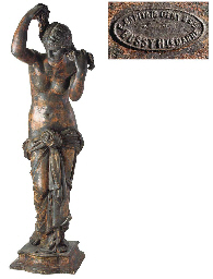 A FRENCH CAST IRON FIGURE OF A