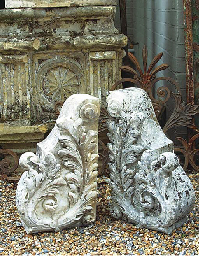 A PAIR OF WHITE MARBLE CORBELS