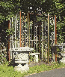 A PAINTED IRON GAZEBO