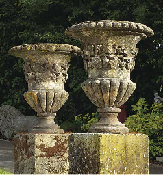 A PAIR OF BATH STONE ORNAMENTA