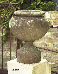 A PAIR OF SANDSTONE URNS