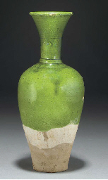 A Chinese green glazed taperin