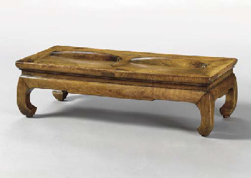 A HUALI FOOTREST WITH ROLLERS,