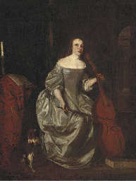 A lady playing a cello in an i