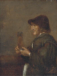A peasant man smoking a pipe i