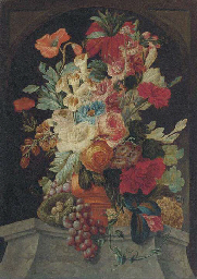 Mixed flowers in an urn on a l