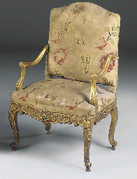 A CARVED GILTWOOD FAUTEUIL