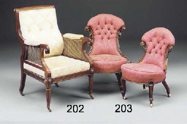 A MAHOGANY AND CANED ARMCHAIR