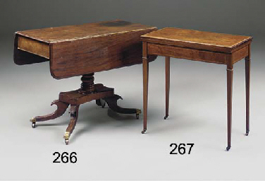 A MAHOGANY DROP LEAF TABLE