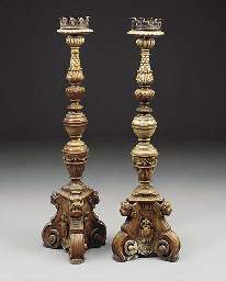 A PAIR OF CARVED TORCHERES