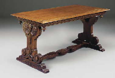 A CARVED OAK CENTRE TABLE
