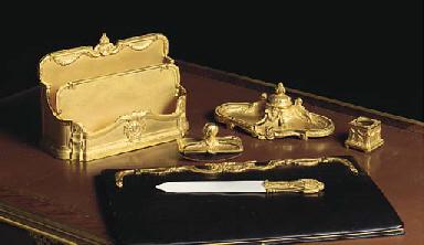 A French ormolu six-piece desk