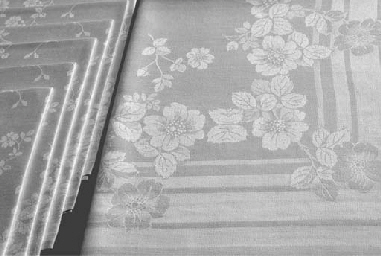 (7) A set of six damask linen