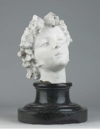 A CARVED MARBLE HEAD OF A MAID